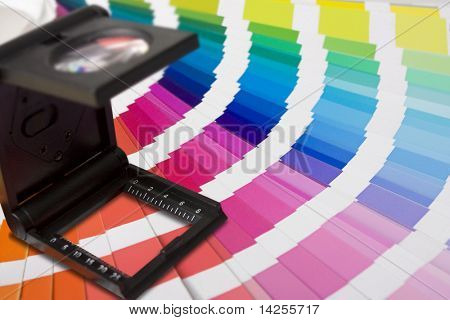 selection of colour swatches and printers or photographers lupe