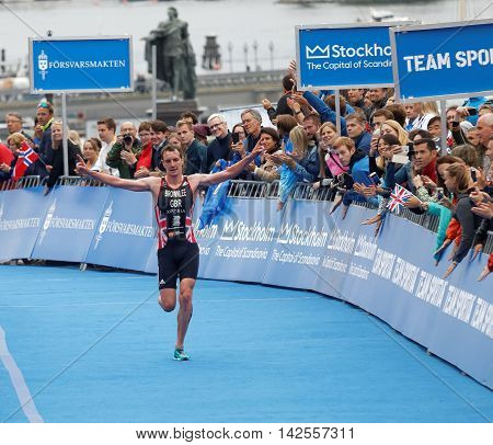 STOCKHOLM - JUL 02 2016: Triathlete Alistair Brownlee winning the race and raising his arms in the Men's ITU World Triathlon series event July 02 2016 in Stockholm Sweden