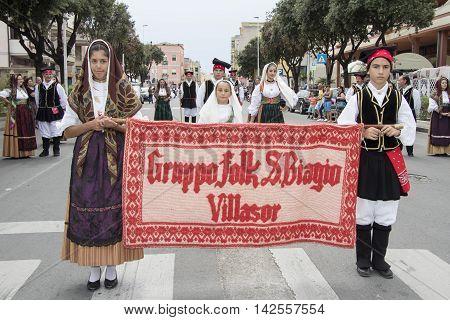 QUARTU S.E., ITALY - September 15, 2013: Wine Festival in honor of the celebration of St. Helena - Sardinia - Parade of folk group San Biagio di Villasor
