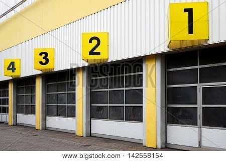 industrial warehouse building with numbered roll-up doors