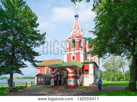 UGLICH RUSSIA - JULY 19 2016: Unidentified people walk near old Church of Tsarevich Dmitry on Blood Uglich Russia