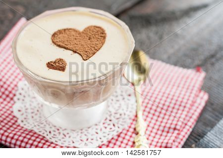 Dessert Tiramisu Decorated With Hearts On A Red Napkin And A Gold Spoon