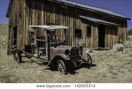 Remains of a 1918 Dodge Truck sits outside an abandoned building in Berlin, NV ghost town.