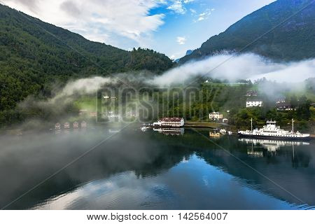 Foggy Air Over Scandinavian Mountains And Norwegian Village, Flam