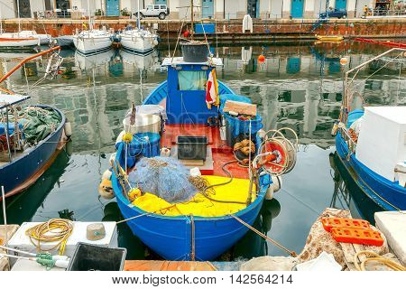 Fishing multi-colored boats in the old port of Genoa. Italy.