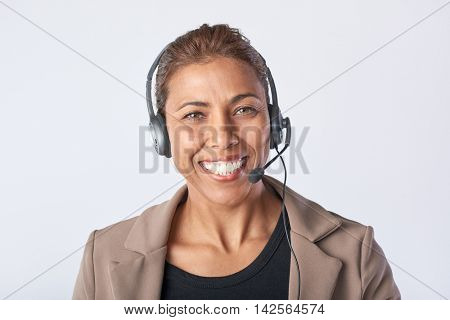 Portrait of latino woman with headphones Consulting and assistance service call center