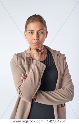 Real woman portrait in studio, serious business woman