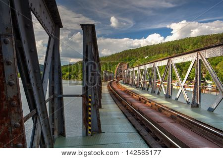 Single track railway bridge over the Vltava river Czech Republic - HDR Image