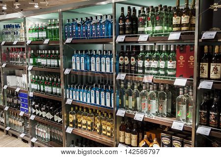 OSLO GARDERMOEN NORWAY - NOVEMBER 2: Department of alcohols in Duty Free Shop at Oslo Gardermoen International Airport on november 2 2014 in Oslo. Alcohols in Norway is one of the most expensive in Europe.