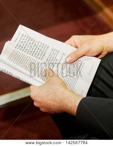 Hand Of Boy Reading The Jewish Torah At Bar Mitzvah 01 August 2015