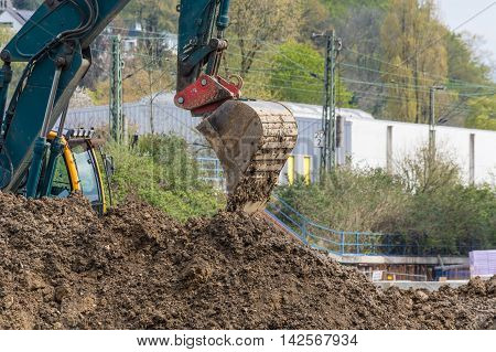 Close-up view of a construction site with excavator