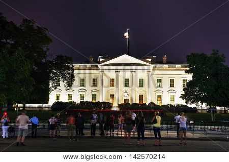 WASHINGTON DC - SEPTEMBER 2: The White House building with tourists on September 2 2015 in Washington DC. The White House is the official residence and principal workplace of the President of the United States