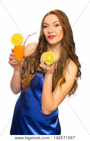 Beautiful standing woman with glass of orange juice and orange fruit isolated on white background