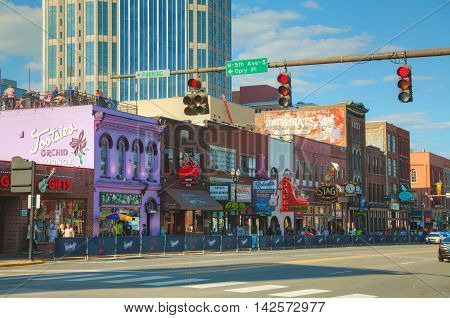 NASHVILLE - AUGUST 28: Downtown Nashville with people on August 28 2015 in Nashville TN. Nashville is the capital of the State of Tennessee and the county seat of Davidson County.