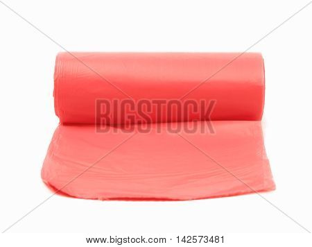 Red plastic polyethylene trash bag roll isolated over the white background