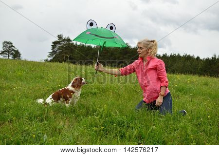 Dog And Lady Under Umbrella