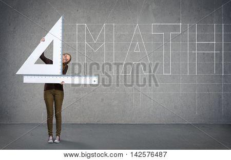 Funny schoolgirl with big ruler, mathematics concept