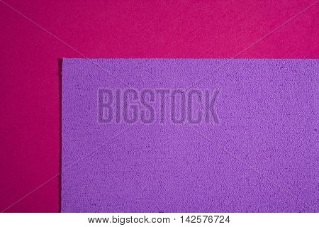 Eva foam ethylene vinyl acetate sponge plush light purple surface on pink smooth background