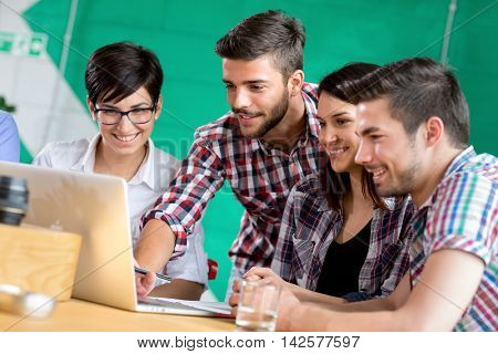 students busy in coffee shop