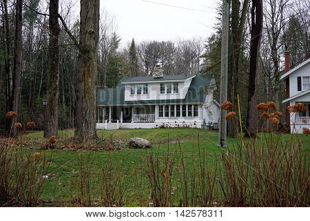 A white home with a front porch in Wequetonsing, Michigan.