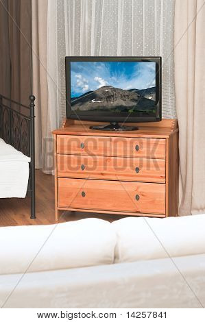 The Big Tv In A Room Before White Sofa
