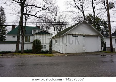WEQUETONSING, MICHIGAN / UNITED STATES - DECEMBER 22, 2015: The garage of a home on Beach Road in Wequetonsing, Michigan.