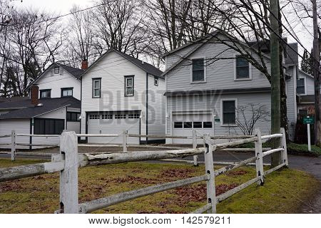 WEQUETONSING, MICHIGAN / UNITED STATES - DECEMBER 22, 2015: Homes with attached garages in Wequetonsing, Michigan.