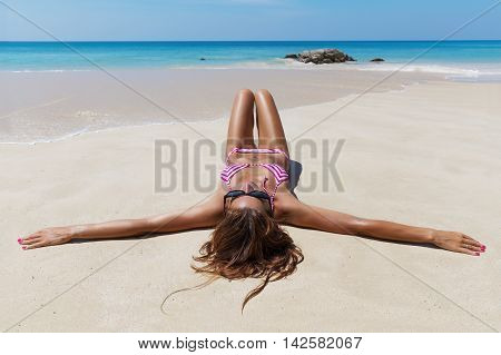 Pretty Slim Brunette Woman In Sunglasses Sunbathe On The Beach