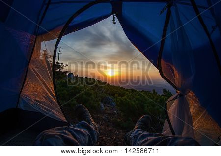 Dawn of the tent on the top of mountain