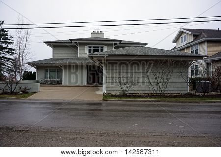 WEQUETONSING, MICHIGAN / UNITED STATES - DECEMBER 23, 2015: A large, elegant home on Beach Drive in Wequetonsing, Michigan.