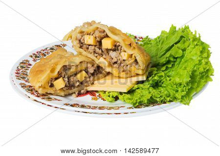 Caucasian pie stuffed with meat and cheese (cheburek) on plate isolated