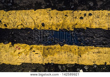 Grungy Double Yellow Line Road Markings On A British Street