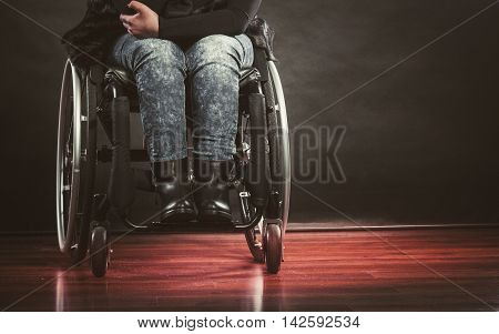 Disease disability paralysis handicap health concept. Legs of disabled person. Crippled female sitting on wheelchair.