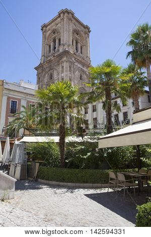 Encarnacion Cathedral bell tower with a pavement cafe in the foreground Granada Spain