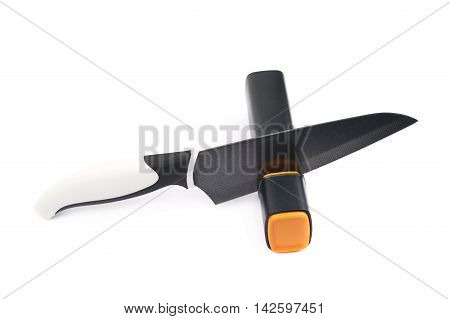 Knife in a plastic black sharpener tool, composition isolated over the white background