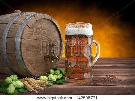 glass of oktoberfest beer with keg, barley and hops on wooden desk - 3D render