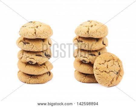 Stack pile of soft chewy chocolate chip cookies, composition isolated over the white background, set of two different foreshortenings
