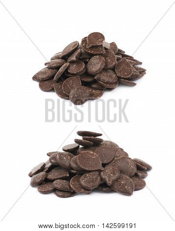 Pile of cooking chocolate teardrop shaped chips isolated over the white background, set of two different foreshortenings