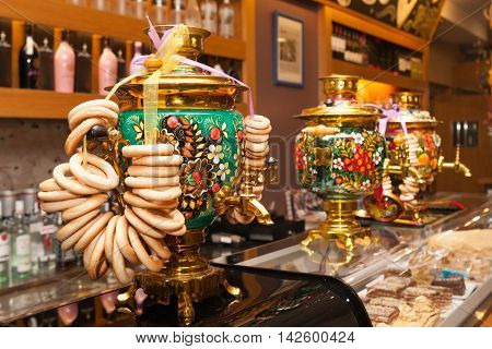 Barcelona ,Spain, May 2016: Khokhloma painting traditional Russian samovar with bunch of crackers bagels in Russian restaurant