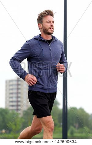 Determined Jogger In Workout Routine