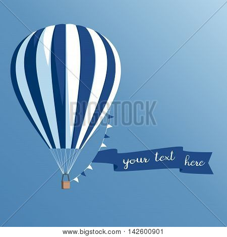Hot air balloon with a banner on a blue background striped hot air balloon with ribbon and flags flying in the sky