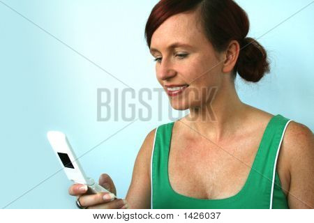 Woman Texting On A Cell Phone