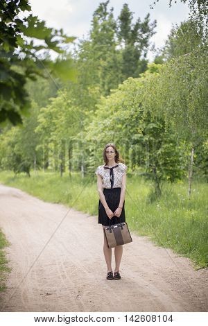 Girl Walking In The Forest