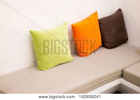 modern living room interior with leather sofa and colorful pillow