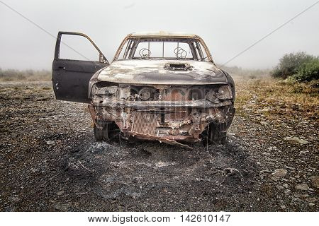 Abandoned Burnt Out Car On Common Land.