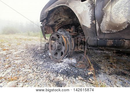 Front Wheel Remains Of A Burnt Out Car