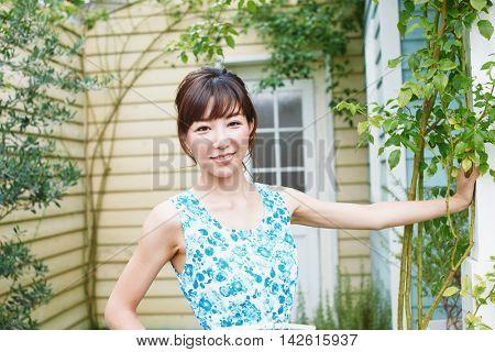 Beautiful asian woman relaxing in the terrace