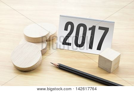 2017 New Year On Business Card With Blank Wooden Round Piece And Pencil,holiday Concept