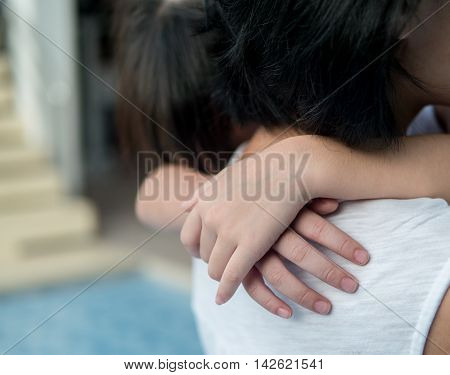 Asian Baby Girl Hugging Her Mother , Sleepy, , Selective Focus