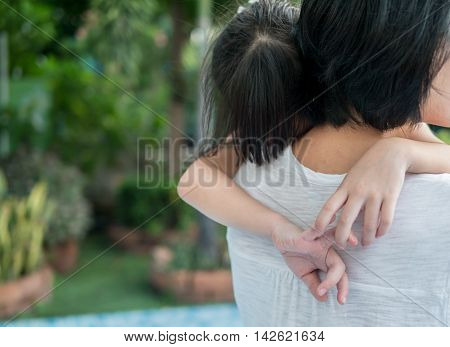 Asian Baby Girl Hugging Her Mother , Sleepy, , Selective Focus At Hands